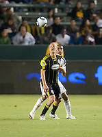 Columbus Crew forward Steven Lenhart (32) and Galaxy defender Leonardo (22) wait for the ball during the second half of the game between LA Galaxy and the Columbus Crew at the Home Depot Center in Carson, CA, on September 11, 2010. LA Galaxy 3, Columbus Crew 1.