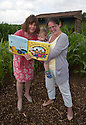 09/07/14<br /> <br /> L/R:  Julia Donaldson and Oliver Heighington (20 months) and his mum Nina Heighington.<br /> <br /> A ten acre field of maize is turned into a giant scarecrow maze. The characters are from from Julia Donaldson's new book - The Scarecrows' Wedding. The Gruffalo author was joined by the books' illustrator, Axel Scheffler to open the maze today at The National Forest Adventure Farm, Tattenhill, Staffordshire. <br /> All Rights Reserved: F Stop Press Ltd. +44(0)1335 300098   www.fstoppress.com.
