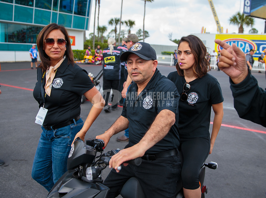 Mar 15, 2019; Gainesville, FL, USA; NHRA team owner Mike Salinas (center) with wife Monica Salinas (left) and daughter Jasmine Salinas during qualifying for the Gatornationals at Gainesville Raceway. Mandatory Credit: Mark J. Rebilas-USA TODAY Sports