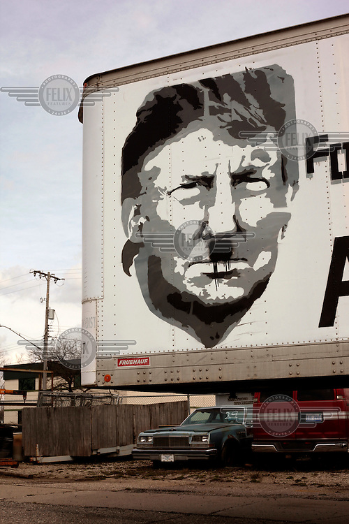 "A campaign advert for Republican presidential candidate Donald Trump in Flint, Michigan, which reads: ""Vote Donald Trump for President - Make America Great Again"" has been defaced, with 'great' changed to 'hate' and a Hitler moustache drawn on Trumps face."