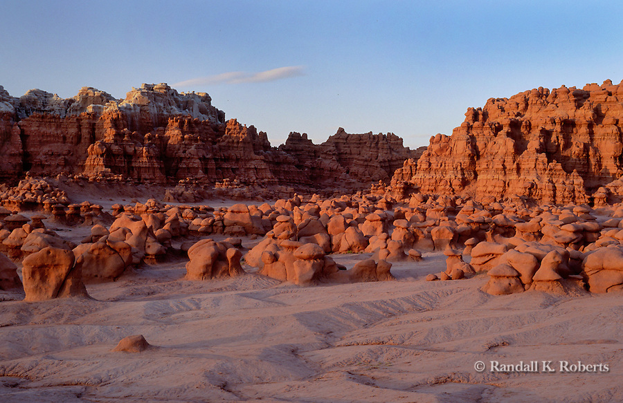 Eroded sandstone rock formations at dusk, Goblin Valley State Park, Utah, at the edge of the San Rafael Desert.