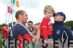 Enda O'Shea with his godson Fergal from Killorglin loved collecting  autographs from Paul Warwick and other team players from the Munster Rugby team during their visit to Tralee on Friday.