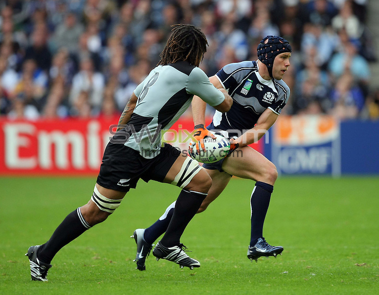 PICTURE BY VAUGHN RIDLEY/SWPIX.COM - Rugby Union - Rugby World Cup 2007 - Scotland v New Zealand - Murrayfield, Edinburgh, Scotland - 23/09/07...Copyright - Simon Wilkinson - 07811267706..Scotland's Simon Webster and New Zealand's Rodney So'oialo.