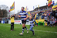 Nathan Catt of Bath Rugby, mascot in hand, runs out onto the field. Aviva Premiership match, between Bath Rugby and Saracens on December 3, 2016 at the Recreation Ground in Bath, England. Photo by: Patrick Khachfe / Onside Images