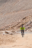 Mountain biking on the highest motorable road in the world,  Himalayan Mountains, Ladakh, India.
