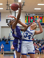 NWA Democrat-Gazette/BEN GOFF @NWABENGOFF<br /> Ally Figenskau (34) of Rogers fouls Coriah Beck of Fayetteville Friday, Feb. 9, 2018, in King Arena at Rogers High.