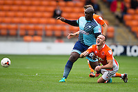Tom Aldred of Blackpool feels the power of Adebayo Akinfenwa of Wycombe Wanderers during the Sky Bet League 2 match between Blackpool and Wycombe Wanderers at Bloomfield Road, Blackpool, England on 20 August 2016. Photo by James Williamson / PRiME Media Images.