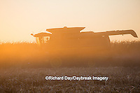 63801-06712 John Deere combine harvesting corn at sunset, Marion Co., IL