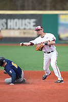 Virginia Tech Hokies second baseman Alex Perez (8) turns a double play as Matt Hansen (5) of the Toledo Rockets slides into second base at The Ripken Experience on February 28, 2015 in Myrtle Beach, South Carolina.  The Hokies defeated the Rockets 1-0 in 10 innings.  (Brian Westerholt/Four Seam Images)