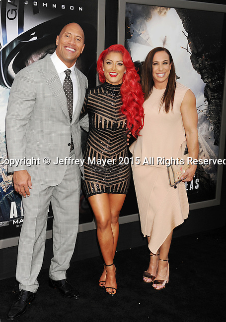 "HOLLYWOOD, CA - MAY 26: (L-R) Actor Dwayne ""The Rock"" Johnson, WWE Diva Eva Marie and producer Dany Garcia arrive at the 'San Andreas' - Los Angeles Premiere at TCL Chinese Theatre IMAX on May 26, 2015 in Hollywood, California."