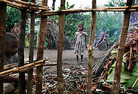 ÒSave the Pygmies FoundationÓ Building Front..Save the Pygmies (Programme de Assistance au Pygmy--PAP) took us to camps outside Beni.  They are based in Beni where there are no pygmies.  They had an office in Edou but they say it is too dangerous for them to work there.   We visited two camps of pygmies... the first camp had leaf huts and were basically refugees without a forest.  The second group had mud huts that I have only seen with Bantus... they have become sedentary.  The OFP still has wildlife... there are many empty forests around there with no forest elephant or forest giraffe... by the time logging gets to an area, it is completely bereft...  these pygmies are trying to survive in a yet worse situation around developed cities of approximately 225,000-450,000 (2002 census).....