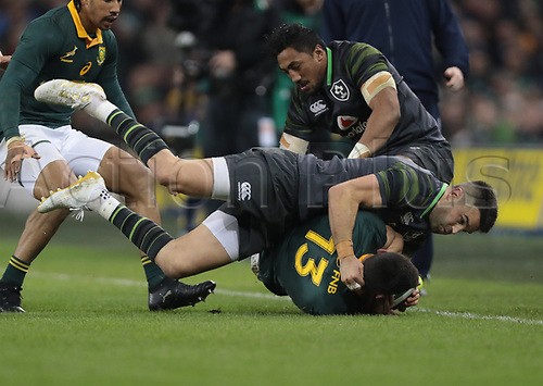 11th November 2017, Aviva Stadium, Dublin, Ireland; Autumn International Series, Ireland versus South Africa; Jesse Kriel (South Africa) is tackled in to touch by Bundee Aki (Ireland)  and Conor Murray (Ireland)