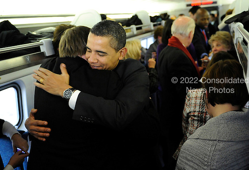 Baltimore, MD - January 17, 2009 -- United States President-elect Barack Obama greets train riders during the Whistle Stop Train Tour, outside of Baltimore, Maryland on Saturday, January 17, 2009. The ceremonial trip will carry President-elect Obama, Vice President-elect Biden and their families to Washington for their inaugurations with additional events in Philadelphia, Wilmington and Baltimore. Obama will be sworn in as the 44th President of the United States on January 20, 2009. .Credit: Kevin Dietsch - Pool via CNP