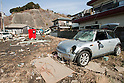 Mar. 13, 2011 - Kita-Ibaraki, Japan - A car is shown piled up in a residential neighborhood two days after the 8.9 magnitude earthquake struck followed by a tsunami that hit the north-eastern region. The death toll is currently unknown with casualties that may run well into the thousands.
