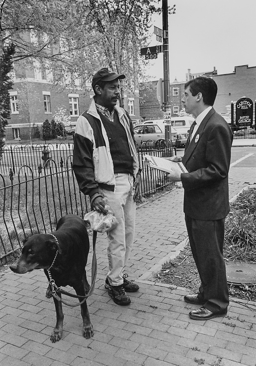 Candidate Rep. John Capozzi, D-D.C., speaks to Jim Lee, Capitol Hill resident asking for vote, on April 24, 1997. (Photo by Laura Patterson/CQ Roll Call via Getty Images)