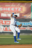 Burlington Royals second baseman Jose Marquez (4) makes a throw to first base against the Johnson City Cardinals at Burlington Athletic Stadium on July 15, 2018 in Burlington, North Carolina. The Cardinals defeated the Royals 7-6.  (Brian Westerholt/Four Seam Images)