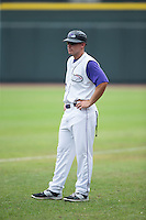 Michael Danner (12) of the Winston-Salem Dash coaches first base during the game against the Wilmington Blue Rocks at BB&T Ballpark on July 29, 2015 in Winston-Salem, North Carolina.  The Dash defeated the Blue Rocks 5-4 in game one of a double-header.  (Brian Westerholt/Four Seam Images)