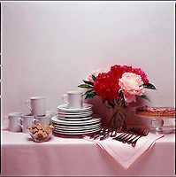 Side board with china, silverware, flowers &amp; pastry<br />