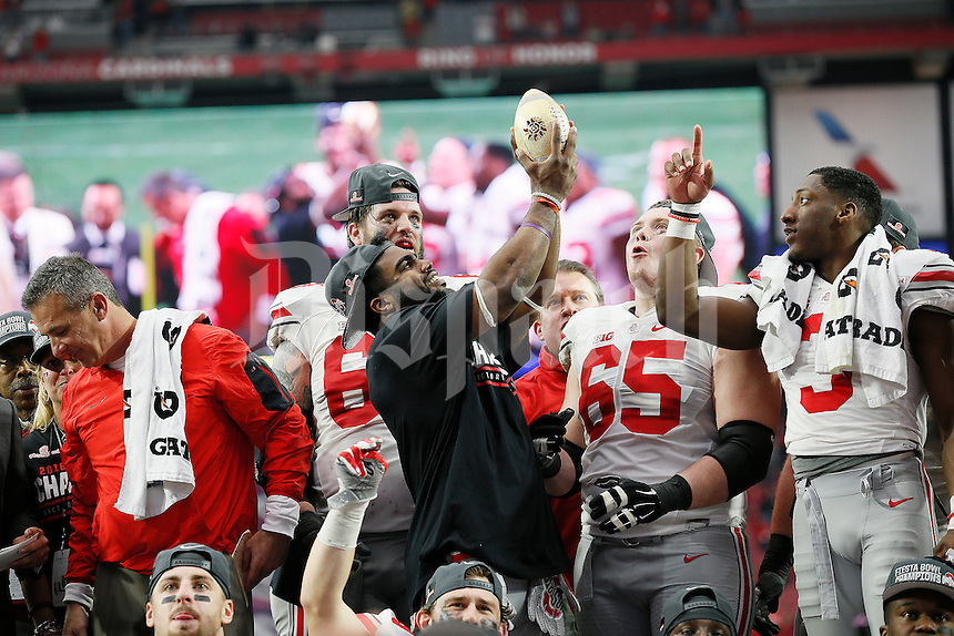 Ohio State Buckeyes running back Ezekiel Elliott (15) hoists the trophy following Ohio State's 44-28 win over the Notre Dame Fighting Irish in the Battlefrog Fiesta Bowl at University of Phoenix Stadium in Glendale, Arizona on Jan. 1, 2016. (Adam Cairns / The Columbus Dispatch)