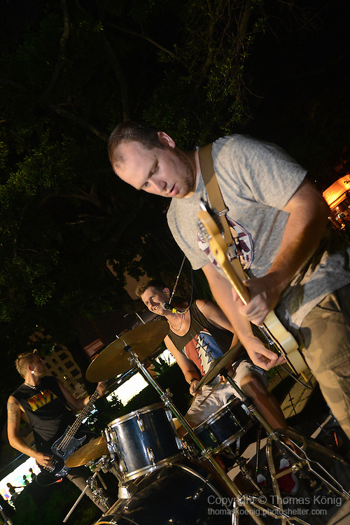 Kaohsiung, Taiwan -- Guitarist Paul Dymott of British Rock 'n' Roll band GOOBER GUN durinmg a performance at the Brickyard Beer Garden.