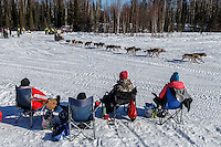 Spectators watch Rick Casillo run by on Long Lake during the Restart of the 2016 Iditarod in Willow, Alaska.  March 06, 2016.