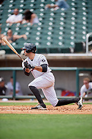 Birmingham Barons first baseman Nick Basto (20) follows through on a swing during a game against the Pensacola Blue Wahoos on May 9, 2018 at Regions FIeld in Birmingham, Alabama.  Birmingham defeated Pensacola 16-3.  (Mike Janes/Four Seam Images)