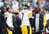Ben Roethlisberger #7 of the Pittsburgh Steelers and head coach Mike Tomlin talk on the sideline in the first half against the Seattle Seahawks during the game at CenturyLink Field on November 29, 2015 in Seattle, Washington. (Photo by Jared Wickerham/DKPittsburghSports)