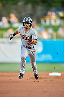 Rico Noel (24) of the Fresno Grizzlies hustles to third base against the Salt Lake Bees at Smith's Ballpark on September 3, 2017 in Salt Lake City, Utah. The Bees defeated the Grizzlies 10-8. (Stephen Smith/Four Seam Images)