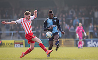 Aaron Pierre of Wycombe Wanderers clears from Ben Kennedy of Stevenage during the Sky Bet League 2 match between Wycombe Wanderers and Stevenage at Adams Park, High Wycombe, England on 12 March 2016. Photo by Andy Rowland/PRiME Media Images.