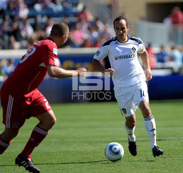 LA forward Landon Donovan (10) plays the ball takes on Chicago defender Steven Kinney (28).  The LA Galaxy tied the Chicago Fire 1-1 at Toyota Park in Bridgeview, IL on September 4, 2010