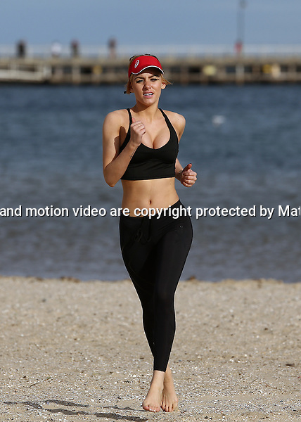 22 JUNE 2014 MELBOURNE VICTORIA<br /> <br /> EXCLUSIVE PICTURES<br /> <br /> Gabi Greko pictured jogging and exercising  at St Kilda Beach as she is put through her paces by her trainer. The sporty model did a lengthy run along the foreshore before some beach sprints and a cool down of stretches. <br /> <br /> *No internet without clearance*.<br /> MUST CALL PRIOR TO USE <br /> +61 2 9211-1088. <br /> <br /> Matrix Media Group.Note: All editorial images subject to the following: For editorial use only. Additional clearance required for commercial, wireless, internet or promotional use.Images may not be altered or modified. Matrix Media Group makes no representations or warranties regarding names, trademarks or logos appearing in the images.