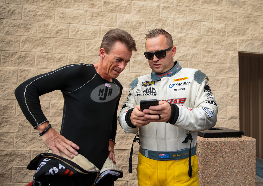 Jul 22, 2018; Morrison, CO, USA; NHRA top fuel driver Clay Millican (left) with Richie Crampton during the Mile High Nationals at Bandimere Speedway. Mandatory Credit: Mark J. Rebilas-USA TODAY Sports