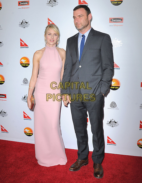 Naomi Watts and Liev Schreiber.at The G'Day USA Black Tie Gala held at The JW Marriot at LA Live in Los Angeles, California, January 12th 2013.                                                                 .full length clutch bag pink high neck dress sleeveless couple blue tie grey grays suit holding hands .CAP/DVS.©Debbie VanStory/Capital Pictures.