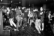 "England. August, 1981. Land Without a Hope. The Derby night-club of Newcastle: The famous ""Pogo"", a violent dance. All steps are allowed, but only male dancers. Here, a group of metal-heads, or black-jackets. A catastrophic economic situation with three million unemployed, probably four million next year, Great Britain is bowed beneath the weight of the crisis. Factories and even whole cities no longer exist on the conomic map. The young poeple, who are the chief victims of this situation, are sinking into a state of despair. Gangs are multiplying, and in the streets, in night-clubs, it is the reign of the brutal metalheads, the provocative punks, the violent skinheads...and the silly sweetness of the ""romantics""."