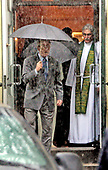 """Washington, D.C. - June 25, 2006 -- United States President George W. Bush and first lady Laura Bush depart St. John's Church in Washington, D.C. on June 25, 2006 with umbrellas up in a downpour at 8:32AM following the service accompanied by the Reverend Dr. Louis Leon, rector of St. John's.  Reverend Leon presided and gave the sermon. The readings were from Job 38, Psalm 107, 2 Corinthians 5 and the Gospel was from Mark 4: 35-41.  In his sermon, Dr. Leon recalled his tearful departure from Cuba as an 11 year-old-boy on August 13, 1961, linking that to the Gospel of the day, which dealt with Jesus calming his disciples and the sea and the wind on a crossing of the Sea of Galilee. He said that Jesus was """"inviting us to go where we never thought we'd go,"""" adding that He offers us """"maximum support and minimum protection."""" Dr. Leon also made a passing reference to FDR's famous statement that we have nothing to fear but fear itself. <br /> Credit: Jay L. Clendenin - Pool via CNP"""