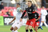 WASHINGTON, DC - MARCH 07: Robbie Robinson #19 of Inter Miami CF battles the ball with Julian Gressel #31 of D.C. United during a game between Inter Miami CF and D.C. United at Audi Field on March 07, 2020 in Washington, DC.