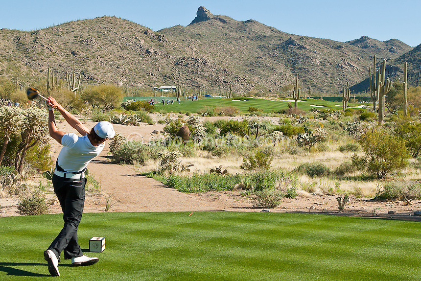 Feb 25, 2009; Marana, AZ, USA; Camilo Villegas (COL) hits his tee shot on the 8th hole during a match against Rod Pampling (AUS-not pictured) during the first round of the World Golf Championships-Accenture Match Play Championship at the Ritz-Carlton Golf Club, Dove Mountain.