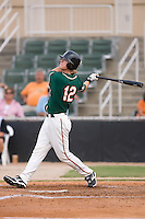 Thomas Hickman (12) of the Greensboro Grasshoppers follows through on his swing at Fieldcrest Cannon Stadium in Kannapolis, NC, Saturday August 24, 2008. (Photo by Brian Westerholt / Four Seam Images)