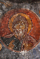 Fresco of Christ Pantocrator, in Yilanli Kilise or St George's Church, known as Snake Church, originally part of a monastery, at the Goreme Open Air Museum in Goreme, in Nevsehir province, Cappadocia, Central Anatolia, Turkey. The church has a simple low barrel-vaulted nave and many frescoes, including St Theodore and St George slaying the dragon, which is depicted as a snake. The churches in Goreme are carved from the soft volcanic tuff created by ash from volcanic eruptions millions of years ago. Early christians came here to flee persecution by the Romans and others settled here under the influence of early saints. This area forms part of the Goreme National Park and the Rock Sites of Cappadocia UNESCO World Heritage Site. Picture by Manuel Cohen
