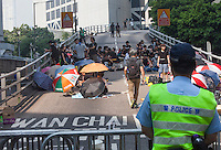 Police and pro-democracy protesters face each other by the Hong Kong Police Headquarters on day three of the mass civil disobedience campaign Occupy Central, Hong Kong, China, 30 September 2014.