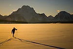 A young man nordic skis on Jackson Lake in Grand Teton National Park, Jackson Hole, Wyoming.