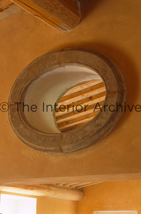 An oval opening high in the wall allows air to circulate keeping the house cool on hot summer days