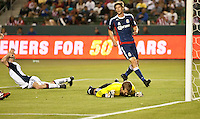 CARSON, CA – APRIL 30, 2011: New England Revolution forward Rajko Lekic (10) agonizes and Chivas USA goalie relief over a deflected shot during the match between Chivas USA and New England Revolution at the Home Depot Center, April 30, 2011 in Carson, California. Final score Chivas USA 3, New England Revolution 0.