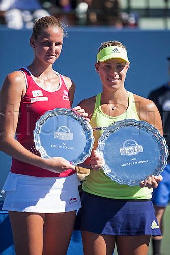 09.08.2015. Stanford, California, USA.  Karolina Pliskova (CZE) (left) and Angelique Kerber (GER) pose with their trophies after the finals of the Bank of the West Classic at Stanford University's Taube Family Tennis Center in Stanford, Calif. Kerber beat Pliskova 2 sets to 1 to become the 2015 Bank of the West Class champion.