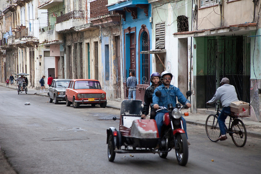 Cuba, Havana. Street Scene, Motorcycle.
