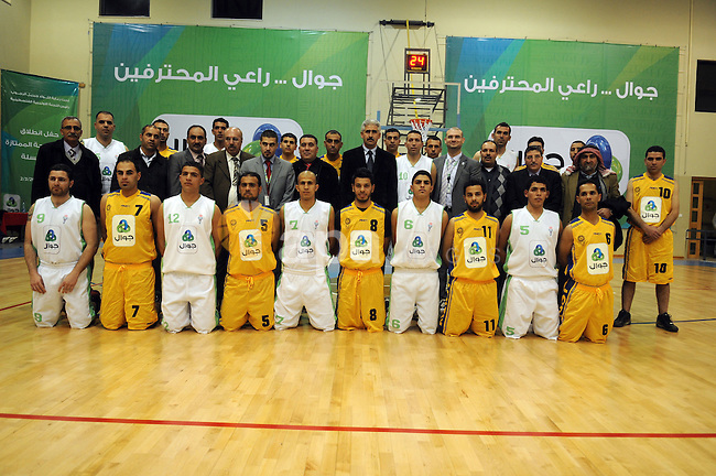 Palestinian basketball players pose for photographs after a basketball game between Abdaa team and Alfaraa team during opening of Premier League for basketball, in the West Bank City of Bethlehem on March 02, 2011. Photo by Najeh Hashlamoun