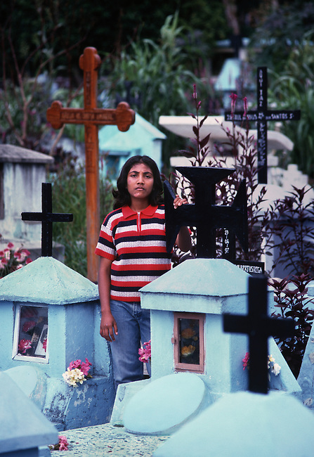 Mina, in the Santa Cruz cemetery. <br /> <br /> She is a survivor of the massacre that took place on this site in 1991, when Indonesian soldiers killed 271 people, who were on a remembrance march for an East Timorese youth who had been killed by the military. <br /> <br /> She was seven years old at the time and was hidden behind the altar of the small church in the cemetery where a lot of the dead were piled up. <br /> <br /> She remembers seeing the New Zealand journalist who was killed, being bayoneted to death at the entrance to the church, by a plain clothed Indonesian.<br /> <br /> East Timor, March 1999.