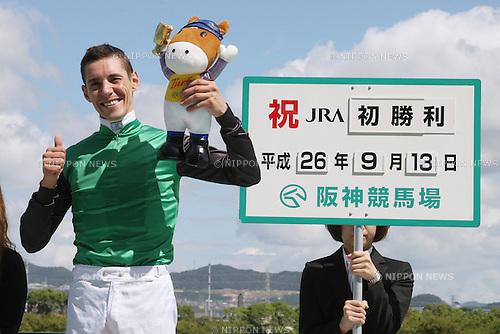 Djordje Perovic,<br /> SEPTEMBER 13, 2014 - Horse Racing :<br /> Jockey Djordje Perovic celebrates his first JRA race win after winning the Hanshin 2R at Hanshin Racecourse in Hyogo, Japan. (Photo by Eiichi Yamane/AFLO)