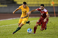 HANG JEBAT STADIUM, MALACCA, MALAYSIA - October 5: Zaher Almedani of Syria (R)  challenges Nikita Rukavytsya of Australia (L) for the ball during the FIFA 2018  World Cup Asian Playoff: Leg 1 match between Syria and Australia at the Hang Jebat Stadium (Photo by Lucas Schifres/Getty Images)