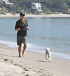 3-28-09.MATTHEW MCCONAUGHEY JOGGING ON MALIBU BEACH WITH HIS DOG....AbilityFilms@yahoo.ocm.805-427-3519.www.AbilityFilms.com
